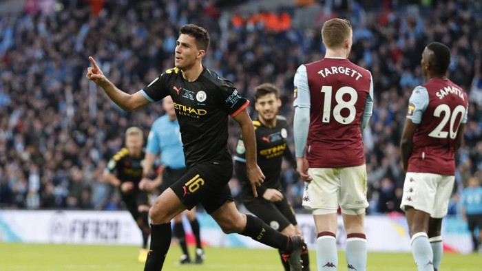 Manchester Citys Rodrigo celebrates after scoring his sides second goal during the League Cup soccer match final between Aston Villa and Manchester City, at Wembley stadium, in London, England, Sunday, March 1, 2020. (AP Photo/Alastair Grant)