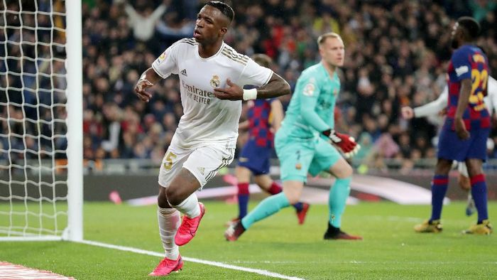 MADRID, SPAIN - MARCH 01: Vinicius Junior of Real Madrid celebrates after scoring his teams first goal during the Liga match between Real Madrid CF and FC Barcelona at Estadio Santiago Bernabeu on March 01, 2020 in Madrid, Spain. (Photo by Gonzalo Arroyo Moreno/Getty Images)