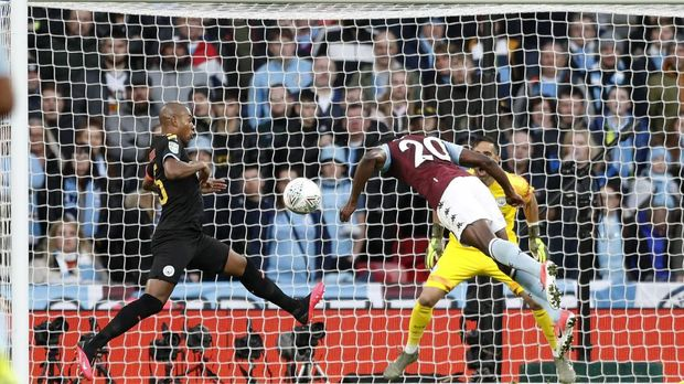 Aston Villa's Mbwana Samatta, right, heads the ball to score his side's first goal during the League Cup soccer match final between Aston Villa and Manchester City, at Wembley stadium, in London, England, Sunday, March 1, 2020. (AP Photo/Alastair Grant)