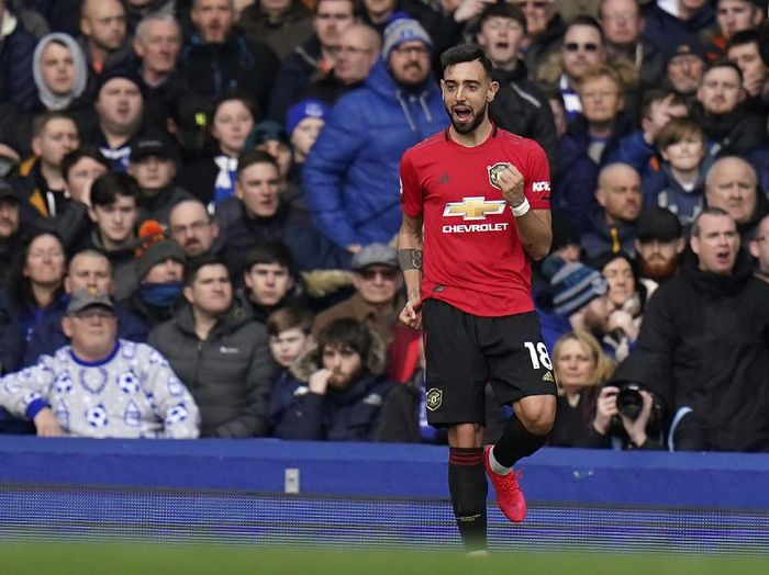 Manchester Uniteds Bruno Fernandes celebrates after scoring his sides first goal during the English Premier League soccer match between Everton and Manchester United at Goodison Park in Liverpool, England, Sunday, March 1, 2020. (AP Photo/Jon Super)