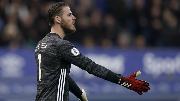 Manchester United's goalkeeper David de Gea gestures during the English Premier League soccer match between Everton and Manchester United at Goodison Park in Liverpool, England, Sunday, March 1, 2020. (AP Photo/Jon Super)