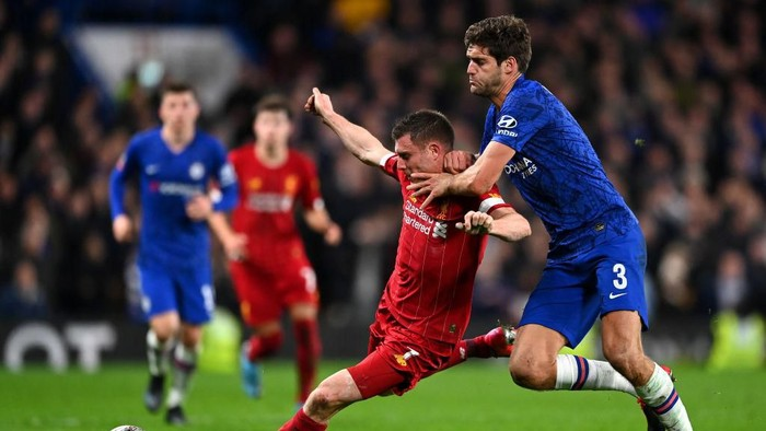 LONDON, ENGLAND - MARCH 03: James Milner of Liverpool is tackled by Marcos Alonso of Chelsea  during the FA Cup Fifth Round match between Chelsea FC and Liverpool FC at Stamford Bridge on March 03, 2020 in London, England. (Photo by Clive Mason/Getty Images)