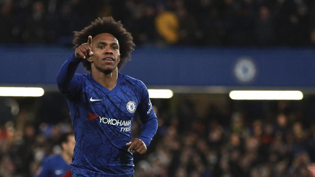 Chelsea's Willian celebrates after scoring his side's opening goal during the English FA Cup fifth round soccer match between Chelsea and Liverpool at Stamford Bridge stadium in London Tuesday, March 3, 2020. (AP Photo/Ian Walton)