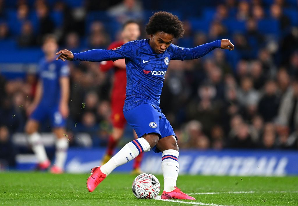 LONDON, ENGLAND - MARCH 03: Willian of Chelsea scores his sides first goal during the FA Cup Fifth Round match between Chelsea FC and Liverpool FC at Stamford Bridge on March 03, 2020 in London, England. (Photo by Clive Mason/Getty Images)