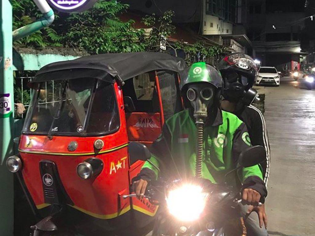 Kendaraan Telat Bayar Pajak Dihancurkan dan Masker Mahal Anti Nuklir Ojol