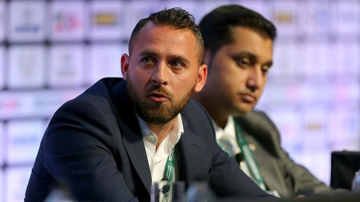 MANCHESTER, ENGLAND - SEPTEMBER 08: Footballer Michael Chopra of Kerala Blasters FC sits with Shirish Kulkarni, President of Liverpool International Football Academy DSK-Shivajians, right,  as they attend the Soccerex European Forum Conference Programme at Manchester Central on September 8, 2014 in Manchester, England.  (Photo by Dave Thompson/Getty Images)