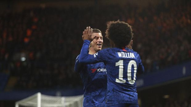 Chelsea's Willian, right, celebrates with Chelsea's Ross Barkley after scoring his side's opening goal during the English FA Cup fifth round soccer match between Chelsea and Liverpool at Stamford Bridge stadium in London Tuesday, March 3, 2020. (AP Photo/Ian Walton)