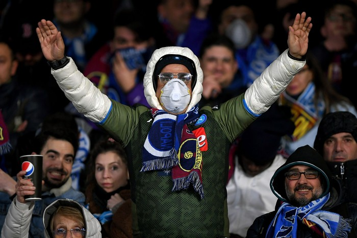 NAPLES, ITALY - FEBRUARY 25: SSC Napoli supporter with a mask due to Coronavirus before the UEFA Champions League round of 16 first leg match between SSC Napoli and FC Barcelona at Stadio San Paolo on February 25, 2020 in Naples, Italy. (Photo by Francesco Pecoraro/Getty Images)