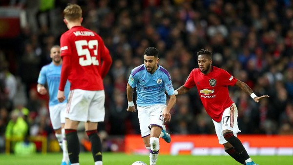 MANCHESTER, ENGLAND - JANUARY 07: Riyad Mahrez of Manchester City takes the ball past Fred of Manchester United during the Carabao Cup Semi Final match between Manchester United and Manchester City at Old Trafford on January 07, 2020 in Manchester, England. (Photo by Michael Steele/Getty Images)