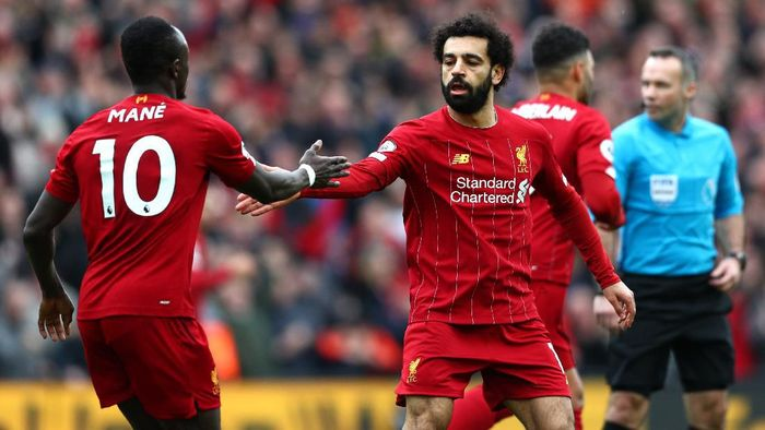LIVERPOOL, ENGLAND - MARCH 07: Mohamed Salah of Liverpool celebrates with Sadio Mane after scoring his teams first goal during the Premier League match between Liverpool FC and AFC Bournemouth  at Anfield on March 07, 2020 in Liverpool, United Kingdom. (Photo by Jan Kruger/Getty Images)