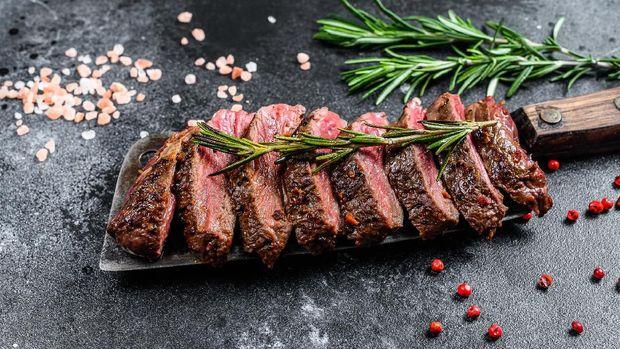 Grilled top blade, Denver steak. Marble meat beef. Black background. Top view.