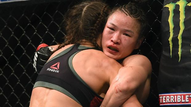 LAS VEGAS, NEVADA - MARCH 07: Weili Zhang hangs on to Joanna Jedrzejczyk winning in a decision to retain her strawweight title at T-Mobile Arena on March 07, 2020 in Las Vegas, Nevada.   Harry How/Getty Images/AFP
