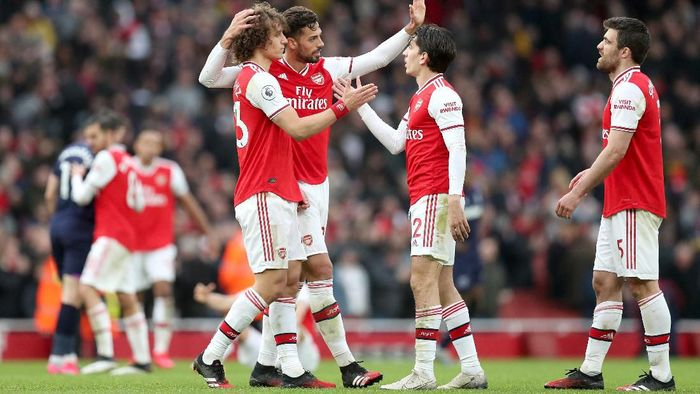 LONDON, ENGLAND - MARCH 07: Players of Arsenal celebrate following the Premier League match between Arsenal FC and West Ham United at Emirates Stadium on March 07, 2020 in London, United Kingdom. (Photo by Alex Morton/Getty Images)