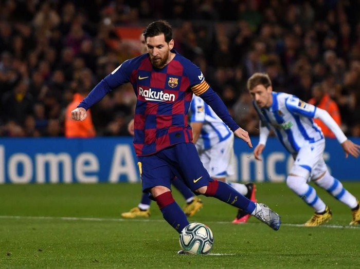 BARCELONA, SPAIN - MARCH 07: Lionel Messi of FC Barcelona scores his teams first goal from the penalty spot during the La Liga match between FC Barcelona and Real Sociedad at Camp Nou on March 07, 2020 in Barcelona, Spain. (Photo by Alex Caparros/Getty Images)