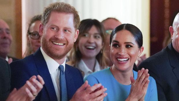 Britain's Prince Harry and Meghan, the Duchess of Sussex, cheer during a marriage proposal at the Endeavour Fund Awards at Mansion House in London, Thursday, March 5, 2020. (Paul Edwards/Pool Photo via AP)