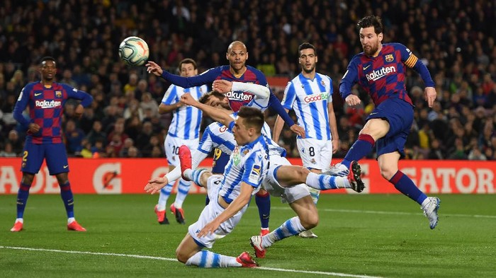 BARCELONA, SPAIN - MARCH 07: Lionel Messi of FC Barcelona shoots during the La Liga match between FC Barcelona and Real Sociedad at Camp Nou on March 07, 2020 in Barcelona, Spain. (Photo by Alex Caparros/Getty Images)