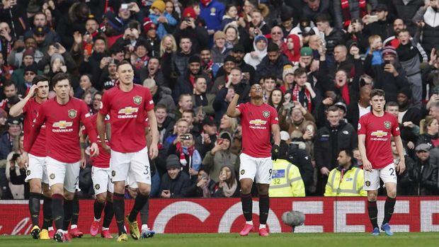 Manchester United's Anthony Martial, second from right, celebrates after scoring the opening goal during the English Premier League soccer match between Manchester United and Manchester City at Old Trafford in Manchester, England, Sunday, March 8, 2020. (AP Photo/Dave Thompson)