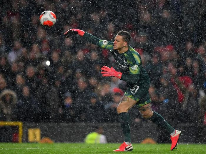 MANCHESTER, ENGLAND - MARCH 08: Ederson of Manchester City clears the ball which leads to Manchester United second goal during the Premier League match between Manchester United and Manchester City at Old Trafford on March 08, 2020 in Manchester, United Kingdom. (Photo by Laurence Griffiths/Getty Images)
