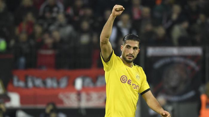 Dortmunds German midfielder Emre Can celebrates scoring during the German first division Bundesliga football match Bayer 04 Leverkusen vs BVB Borussia Dortmund in Leverkusen, western Germany on February 8, 2020. (Photo by INA FASSBENDER / AFP) / RESTRICTIONS: DFL REGULATIONS PROHIBIT ANY USE OF PHOTOGRAPHS AS IMAGE SEQUENCES AND/OR QUASI-VIDEO