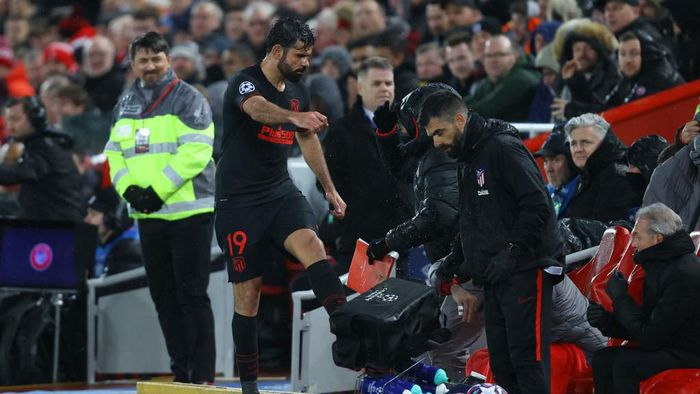 LIVERPOOL, ENGLAND - MARCH 11: Diego Costa of Atletico Madrid kicks a bunch of water bottles as he reacts to being subbed during the UEFA Champions League round of 16 second leg match between Liverpool FC and Atletico Madrid at Anfield on March 11, 2020 in Liverpool, United Kingdom.  (Photo by Julian Finney/Getty Images)