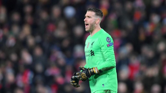 LIVERPOOL, ENGLAND - MARCH 11: Adrian of Liverpool reacts to conceding Atletico Madrids first goal during the UEFA Champions League round of 16 second leg match between Liverpool FC and Atletico Madrid at Anfield on March 11, 2020 in Liverpool, United Kingdom.  (Photo by Laurence Griffiths/Getty Images)