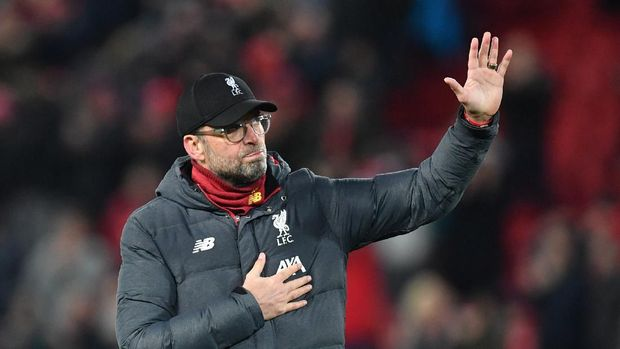 Liverpool's German manager Jurgen Klopp reacts at the final whistle during the UEFA Champions league Round of 16 second leg football match between Liverpool and Atletico Madrid at Anfield in Liverpool, north west England on March 11, 2020. (Photo by Paul ELLIS / AFP)