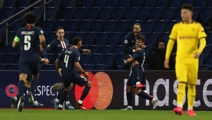 PARIS, FRANCE - MARCH 11: (FREE FOR EDITORIAL USE) In this handout image provided by UEFA, Juan Bernat of Paris Saint-Germain celebrates with Neymar after scoring his teams second goal during the UEFA Champions League round of 16 second leg match between Paris Saint-Germain and Borussia Dortmund at Parc des Princes on March 11, 2020 in Paris, France. The match is played behind closed doors as a precaution against the spread of COVID-19 (Coronavirus).  (Photo by UEFA - Handout/UEFA via Getty Images)