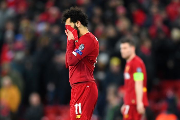 LIVERPOOL, ENGLAND - MARCH 11: Mohamed Salah of Liverpool reacts to defeat after the UEFA Champions League round of 16 second leg match between Liverpool FC and Atletico Madrid at Anfield on March 11, 2020 in Liverpool, United Kingdom.  (Photo by Laurence Griffiths/Getty Images)