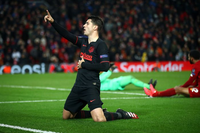 LIVERPOOL, ENGLAND - MARCH 11: Alvaro Morata of Atletico Madrid celebrates after scoring his teams third goal during the UEFA Champions League round of 16 second leg match between Liverpool FC and Atletico Madrid at Anfield on March 11, 2020 in Liverpool, United Kingdom.  (Photo by Julian Finney/Getty Images)