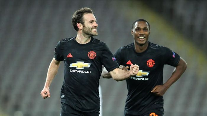 LINZ, AUSTRIA - MARCH 12: (FREE FOR EDITORIAL USE) In this handout image provided by UEFA, Juan Mata of Manchester United celebrates with Odion Ighalo after scoring his teams third goal during the UEFA Europa League round of 16 first leg match between LASK and Manchester United at Linzer Stadion on March 12, 2020 in Linz, Austria. The match is played behind closed doors as a precaution against the spread of COVID-19 (Coronavirus).  (Photo by UEFA - Handout/UEFA via Getty Images )