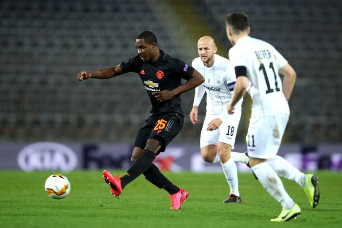 LINZ, AUSTRIA - MARCH 12: (FREE FOR EDITORIAL USE) In this handout image provided by UEFA, Odion Ighalo of Manchester United is challenged by Gernot Trauner and Dominik Reiter of LASK during the UEFA Europa League round of 16 first leg match between LASK and Manchester United at Linzer Stadion on March 12, 2020 in Linz, Austria. The match is played behind closed doors as a precaution against the spread of COVID-19 (Coronavirus).  (Photo by UEFA - Handout/UEFA via Getty Images )