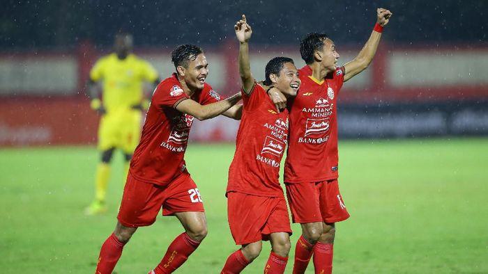 Evan Dimas merayakan golnya saat Persija menghadapi Bhayangkara, Sabtu (14/3/2020)