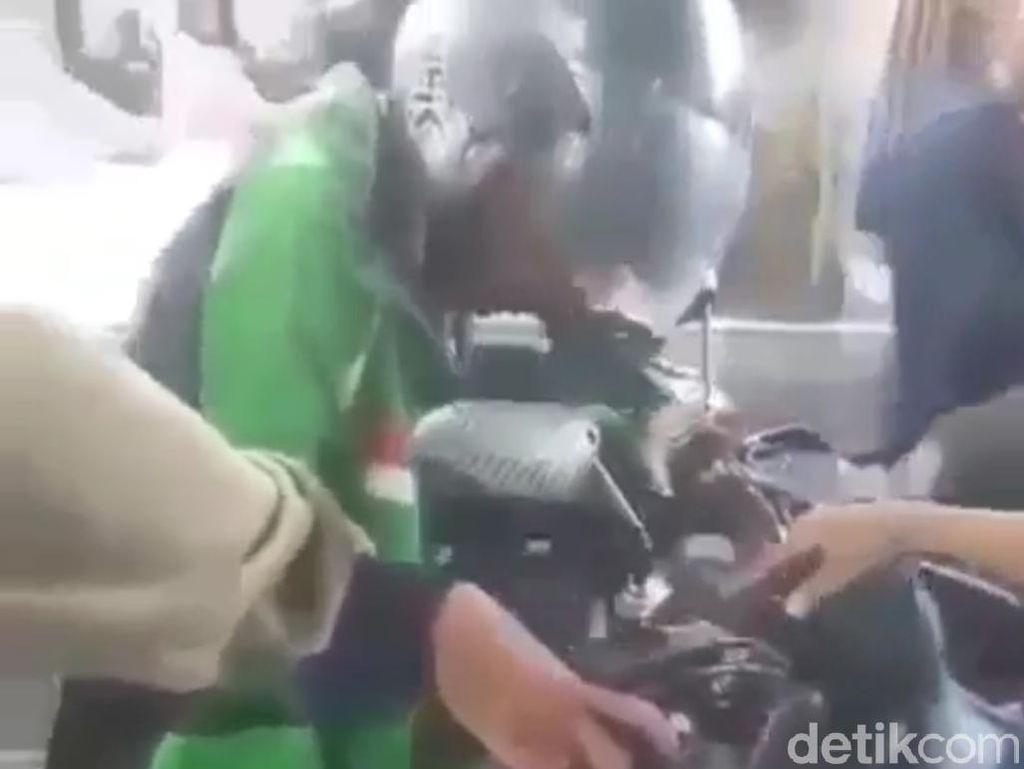 Gojek Pastikan Driver Duduk Membeku di Atas Motor Tak Terkait Corona