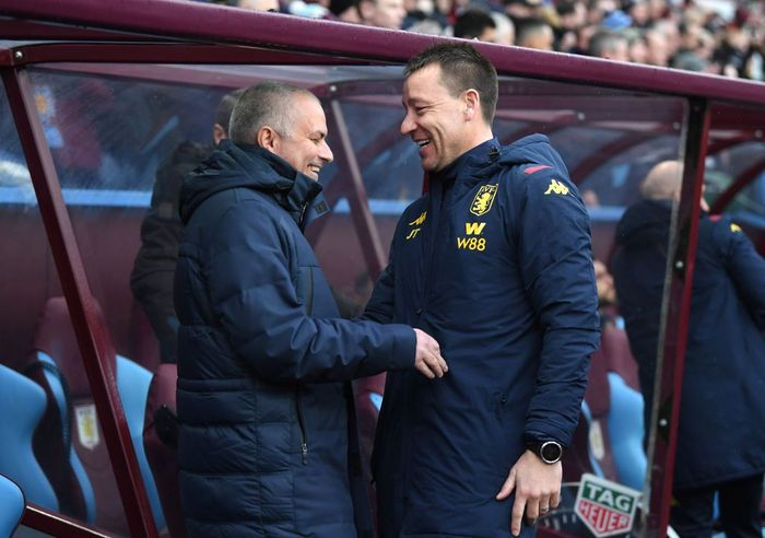 BIRMINGHAM, ENGLAND - FEBRUARY 16: Jose Mourinho, Manager of Tottenham Hotspur shares a joke with Aston Villa assistant Manager John Terry during the Premier League match between Aston Villa and Tottenham Hotspur at Villa Park on February 16, 2020 in Birmingham, United Kingdom. (Photo by Laurence Griffiths/Getty Images)