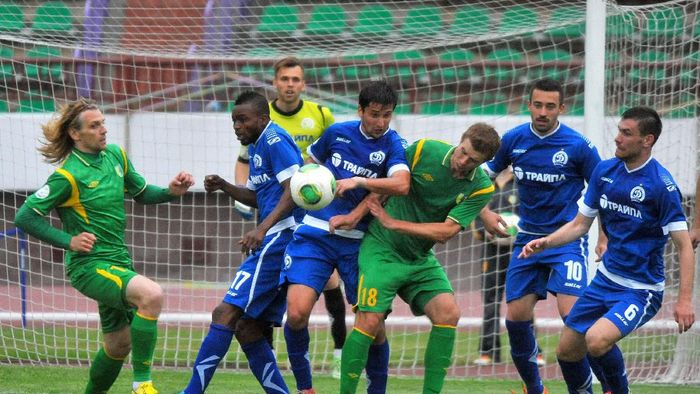 GRODNO,BELARUS - JUNE 15:   Pavel Rybak of FC Neman Grodno (#18)  vies for the ball during the Belarusian Premier League match between FC Neman Grodno and FC Dinamo Minsk at the Neman Stadium on June 15,2014 in Grodno,Belarus. (Photo by Viktor Drachev/EuroFootball/Getty Images)