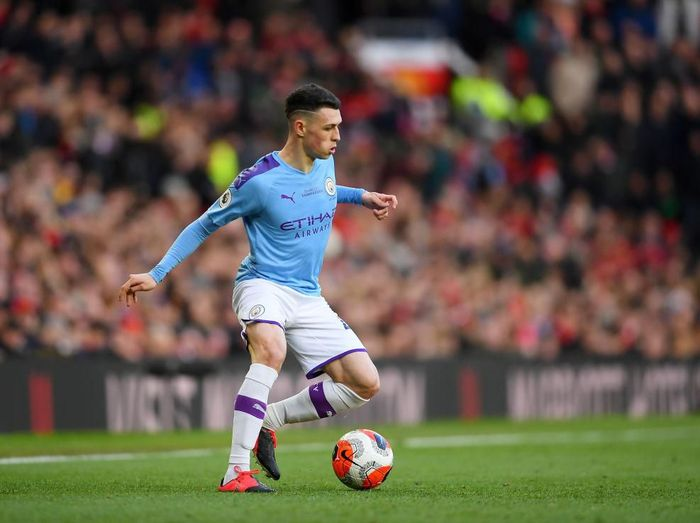 MANCHESTER, ENGLAND - MARCH 08: Phil Foden of Manchester City runs with the ball during the Premier League match between Manchester United and Manchester City at Old Trafford on March 08, 2020 in Manchester, United Kingdom. (Photo by Laurence Griffiths/Getty Images)