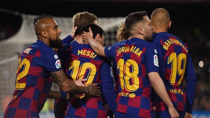 BARCELONA, SPAIN - MARCH 07: Lionel Messi of FC Barcelona celebrates with teammates after scoring his teams first goal  during the La Liga match between FC Barcelona and Real Sociedad at Camp Nou on March 07, 2020 in Barcelona, Spain. (Photo by Alex Caparros/Getty Images)