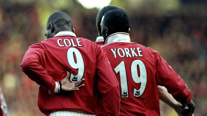 27 Feb 1999:  Dwight Yorke and Andy Cole of Manchester United celebrate a goal together during the FA Carling Premiership match against Southampton played at Old Trafford in Manchester, England.  The match finished in a 2-1 win for Manchester United.  Mandatory Credit: Laurence Griffiths /Allsport
