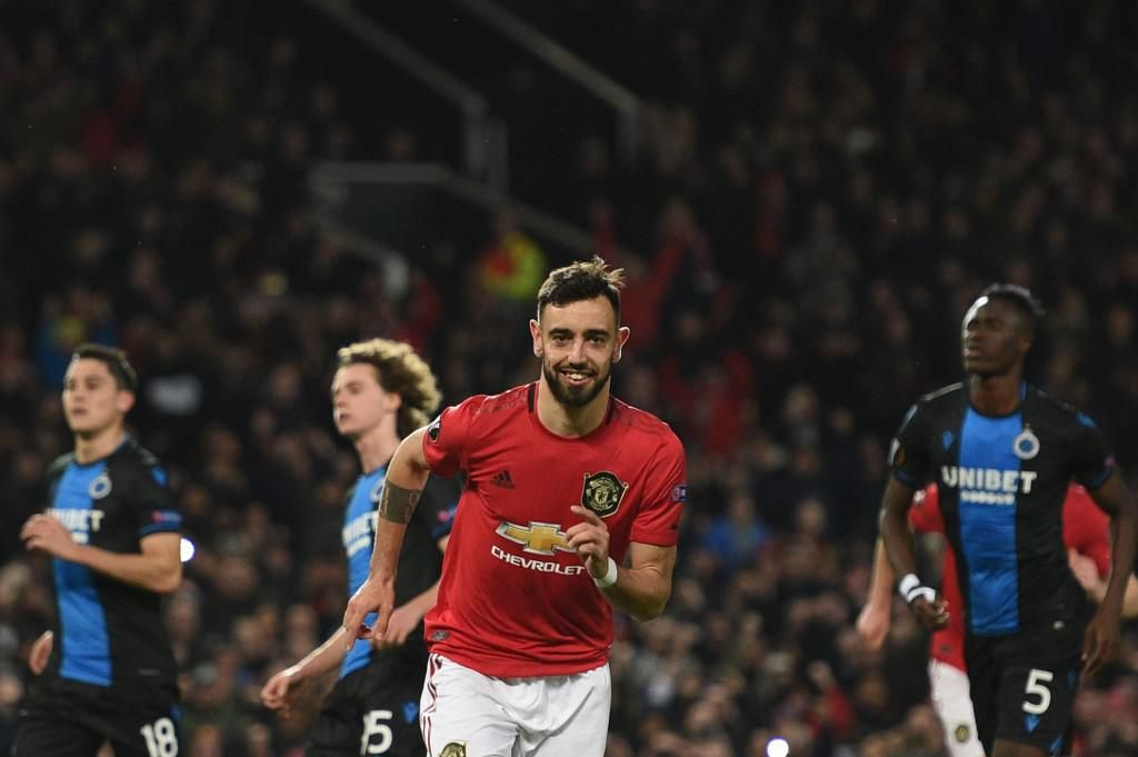 Manchester United's Portuguese midfielder Bruno Fernandes celebrates scoring his team's first goal during the UEFA Europa League round of 32 second leg football match between Manchester United and Club Brugge at Old Trafford in Manchester, north west England, on February 27, 2020. (Photo by Oli SCARFF / AFP)