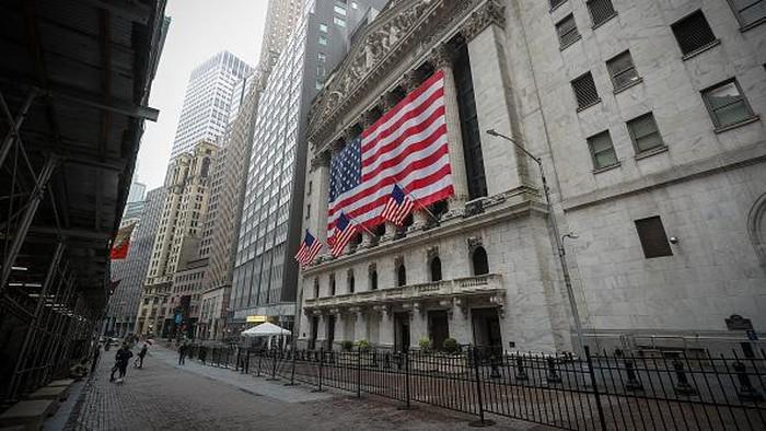 Pusat bisnis di New York, Wall Street terlihat kosong melompong sebagai dampak  pandemi Covid-19, Minggu (29/3/2020).