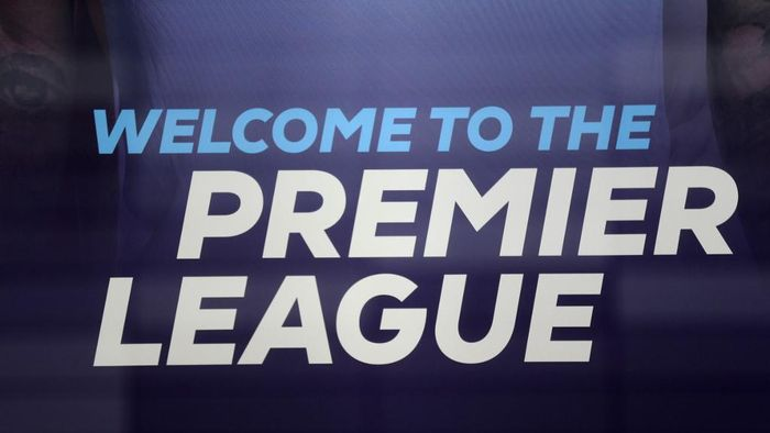 The logo is pictured through a glass window at the headquarters of the English Premier League in London on March 13, 2020. - The English Premier League suspended all fixtures until April 4 on Friday after Arsenal manager Mikel Arteta and Chelsea winger Callum Hudson-Odoi tested positive for coronavirus. (Photo by Isabel Infantes / AFP)
