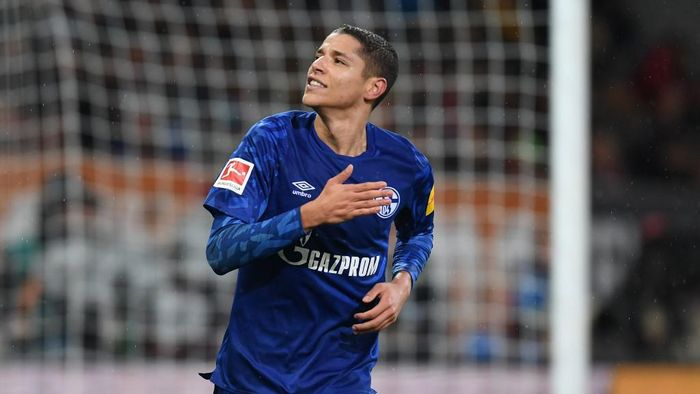 Schalkes French midfielder Amine Harit reacts after scoring during the German first division Bundesliga football match between FC Augsburg and FC Schalke 04 on November 3, 2019 in Augsburg, southern Germany. (Photo by Christof STACHE / AFP) / DFL REGULATIONS PROHIBIT ANY USE OF PHOTOGRAPHS AS IMAGE SEQUENCES AND/OR QUASI-VIDEO
