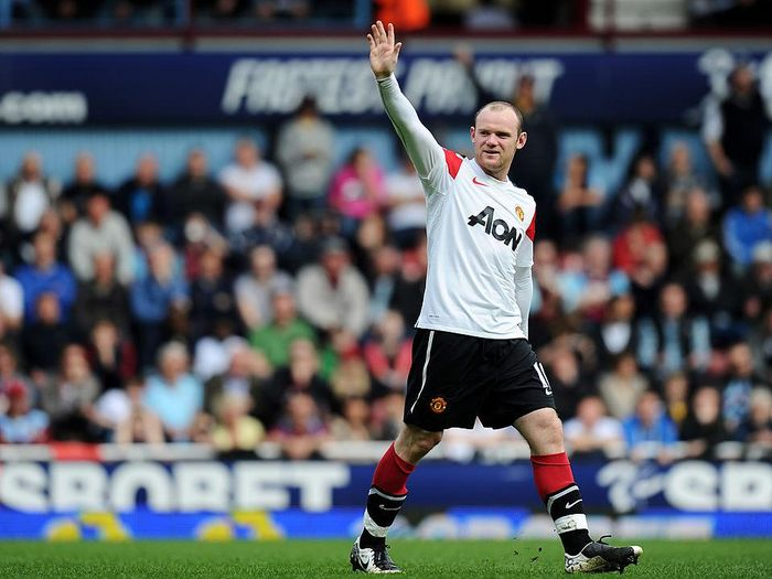 LONDON, ENGLAND - APRIL 02:  Wayne Rooney of Manchester United celebrates his hat trick during the Barclays Premier League match between West Ham United and Manchester United at the Boleyn Ground on April 2, 2011 in London, England.  (Photo by Mike Hewitt/Getty Images)