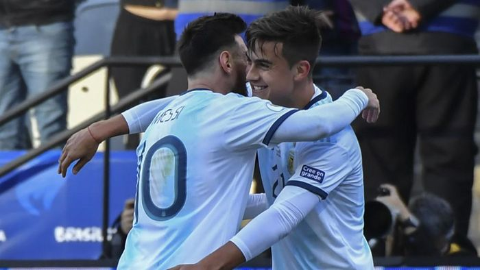 Argentinas Paulo Dybala (R) celebrates with teammate Lionel Messi after scoring against Chile during their Copa America football tournament third-place match at the Corinthians Arena in Sao Paulo, Brazil, on July 6, 2019. (Photo by Nelson ALMEIDA / AFP)