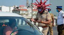 Polisi Berhelm Corona Cegah Warga Keluyuran Jadi Viral