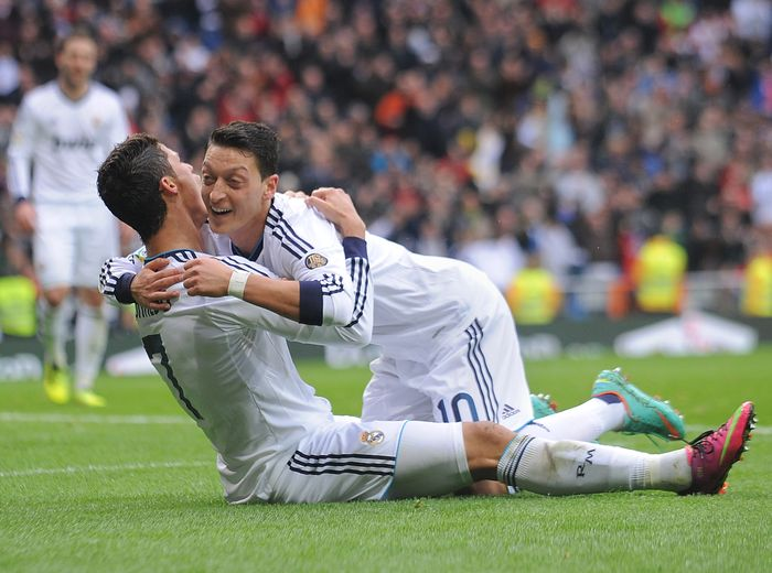 MADRID, SPAIN - JANUARY 27: Mesut Ozil (R) of Real Madrid CF celbrates with Cristiano Ronaldo after Ronaldo scored Reals 2nd goal during the La Liga match between Real Madrid CF and Getafe CF at estadio Santiago Bernabeu on January 27, 2013 in Madrid, Spain.  (Photo by Denis Doyle/Getty Images)
