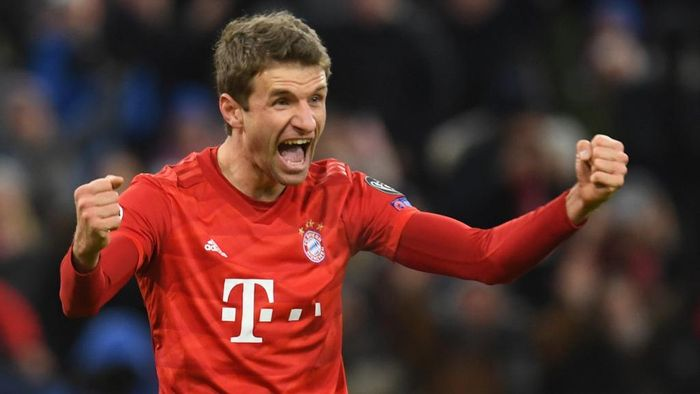 (FILES) In this file photo taken on December 11, 2019 Bayern Munichs German forward Thomas Mueller celebrates scoring during the UEFA Champions League Group B football match between Bayern Munich and Tottenham FC in Munich, Germany. - Thomas Mueller has signed a new deal that will keep the forward at Bayern Munich until 2023, the Bundesliga champions announced on April 7, 2020. (Photo by Christof STACHE / AFP)