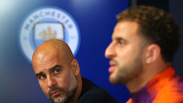 MANCHESTER, ENGLAND - NOVEMBER 06:  Josep Guardiola, Manager of Manchester City and Kyle Walker attend a Manchester City press conference at Manchester City Football Academy on November 6, 2018 in Manchester, England.  (Photo by Alex Livesey/Getty Images)