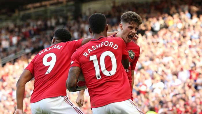 MANCHESTER, ENGLAND - AUGUST 24: Daniel James of Manchester United celebrates scoring his teams first goal with Anthony Martial and Marcus Rashford during the Premier League match between Manchester United and Crystal Palace at Old Trafford on August 24, 2019 in Manchester, United Kingdom. (Photo by Jan Kruger/Getty Images)
