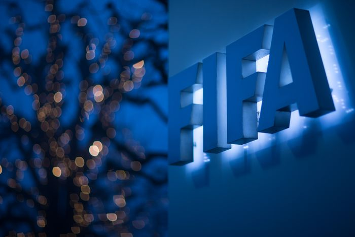 ZURICH, SWITZERLAND - DECEMBER 03: An illuminated FIFA logo sits on a sign at the FIFA headquarters on December 3, 2015 in Zurich, Switzerland. (Photo by Philipp Schmidli/Getty Images)